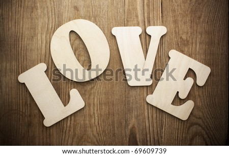 Word LOVE (uppercase) on vintage wood background - stock photo