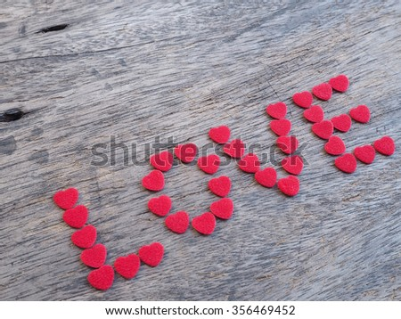 Word Love with heart shapes on wood for Valentine's background