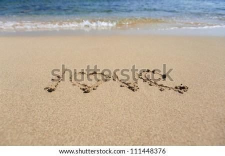 Word love written on sand - stock photo