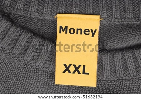 word money on xxl fashion label showing business success concept