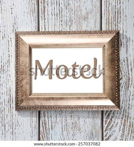 Word Motel in frame on wooden background - stock photo