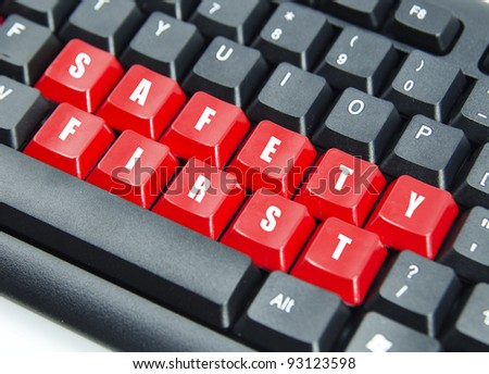 Word of safety first on red keyboard button. - stock photo