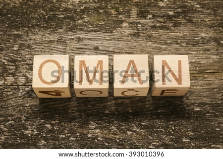 Word OMAN on a wooden background