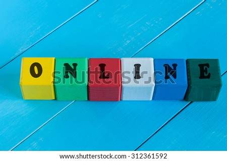 Word Online on children's colourful cubes or blocks. Online shopping concept background. - stock photo