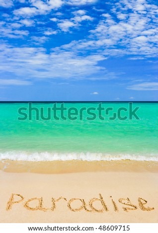 Word Paradise on beach - concept travel background
