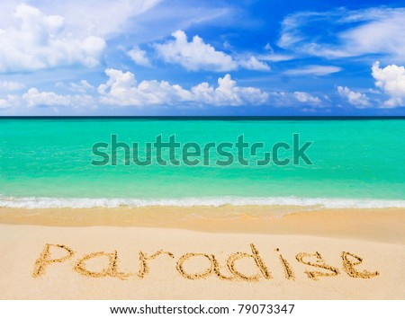 Word Paradise on beach - concept travel background - stock photo