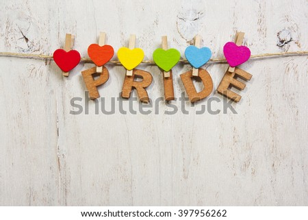 word pride attached rainbow hearts,symbol LGBT - stock photo