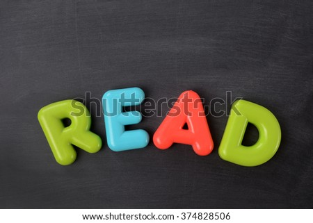 word read on a chalkboard background - stock photo