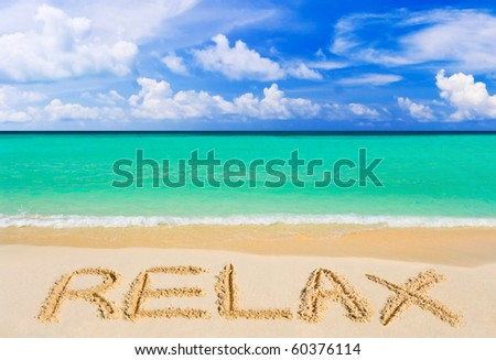 Word Relax on beach - vacation concept background - stock photo