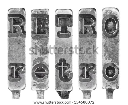 Word RETRO in Old Typewriter Typebar Letters Isolated on White - stock photo