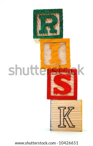 word risk made with toy blocks on a white background - stock photo