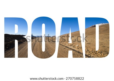 Word ROAD over beautiful landscape - country road in desert valley. The rocky mountains and blue sky are behind. Toned. - stock photo