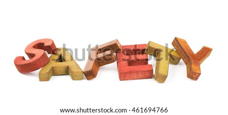 Word Safety made of colored with paint wooden letters, composition isolated over the white background