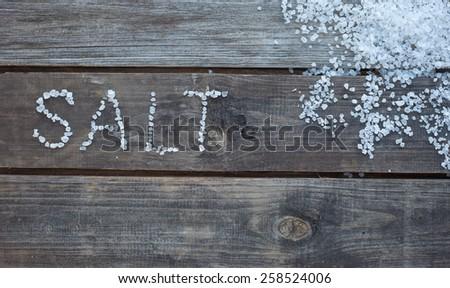 word salt written with sea salt crystals - stock photo