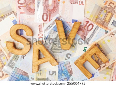 Word Save over the surface covered with the euro bank note bills - stock photo