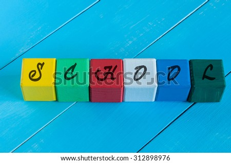 Word School on children's colourful cubes or blocks - educational background for teaching - stock photo