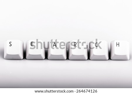 Word search formed with computer keyboard keys on white background with shadow - stock photo