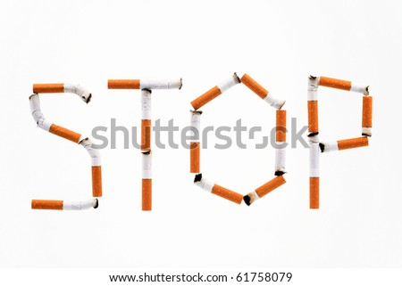 "Word ""Stop"" made of cigaret stubs - stock photo"