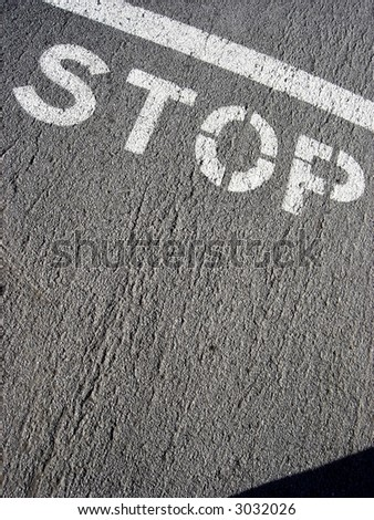 word stop on pavement - stock photo