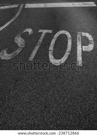 Word Stop painted on asphalt  - stock photo