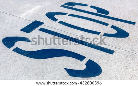 "Word ""STOP"" written on an the road"