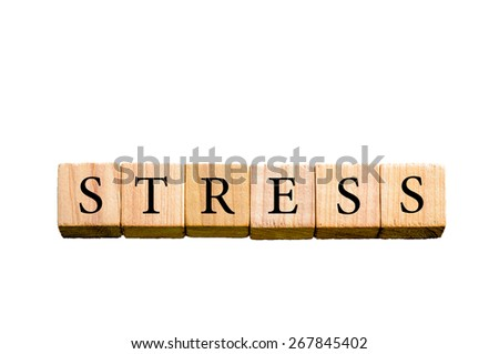 Word STRESS. Wooden small cubes with letters isolated on white background with copy space available. Concept image.