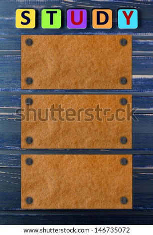 word study on a blue wooden table - stock photo