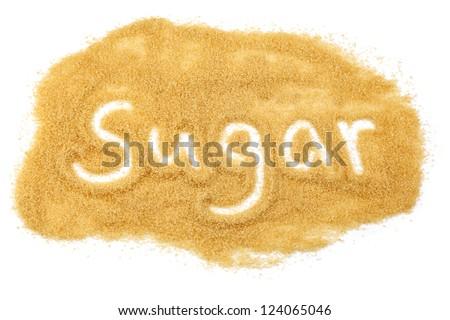 word sugar written in brown granulated demerara sugar - stock photo