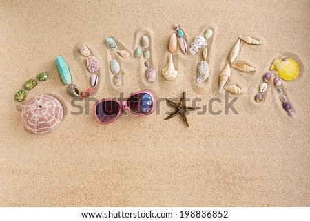 Word summer made from sea shells, with sunglasses and star fish, on sand - stock photo