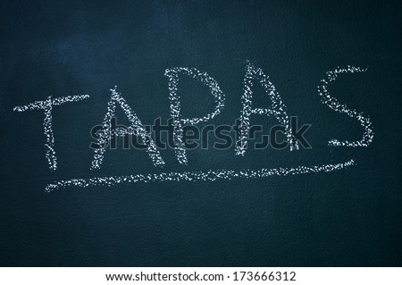word tapas written witch chalk in a chalkboard - stock photo
