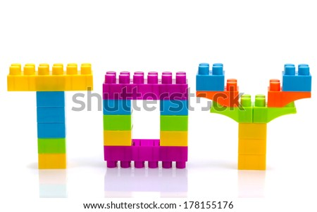 """Word """"toy"""" from toy blocks isolated - stock photo"""