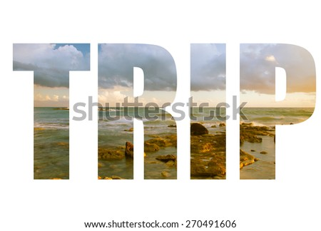 Word TRIP over Seascape  with low clouds above the stony shore of the sea. - stock photo