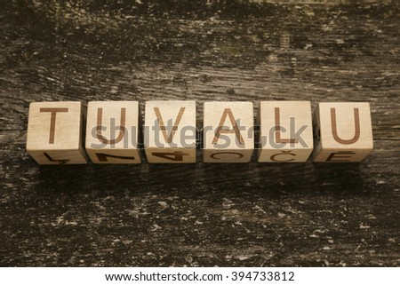 Word TUVALU on a wooden background