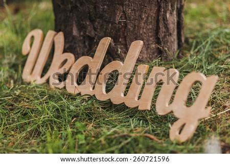 Word wedding. Wedding decor. Caption wedding of wooden letters.  - stock photo