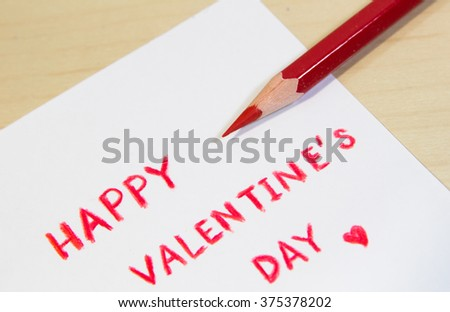 Wording Happy Valentine's Day with rose in small paper