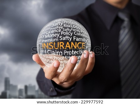 Wording in glowing crystal ball, Life insurance concept - stock photo