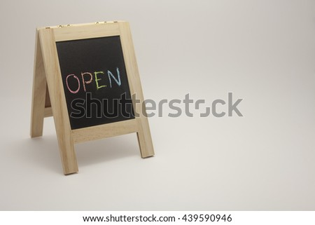 wording open sign concept with small blackboard on white gradient background. colorful chalk - stock photo
