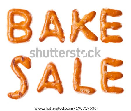 Words BAKE SALE written, laid-out, with crispy alphabet pretzels isolated on white background - stock photo