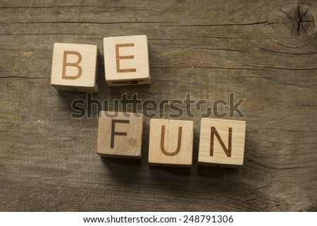 words be fun on a wooden background - stock photo