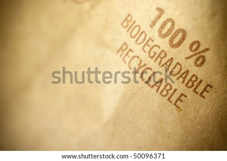 words biodegradable and recyclable written on a brown recycled paper with copyspace