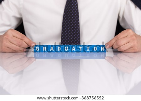 Words GRADUATION with blocks - stock photo