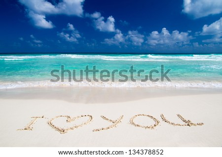 Words I Love You on beach. vacation concept background
