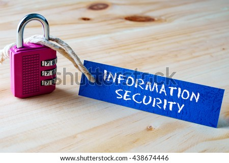Words INFORMATION SECURITY written on tag label tied with a padlock. - stock photo