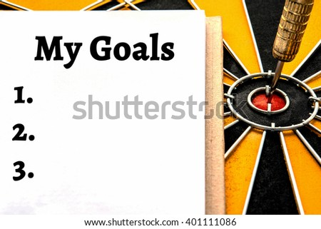 Words my goals setting and dart target arrow on bullseye with copy space, Smart goal target success business investment financial strategy concept, abstract background - stock photo