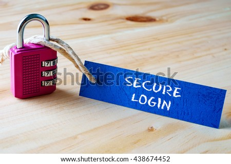 Words SECURE LOGIN written on tag label tied with a padlock. - stock photo