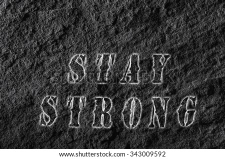 Words stay strong written on black roof tile. - stock photo