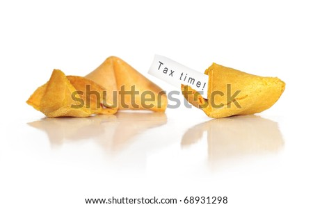 "words ""tax time"" in a fortune cookie - stock photo"