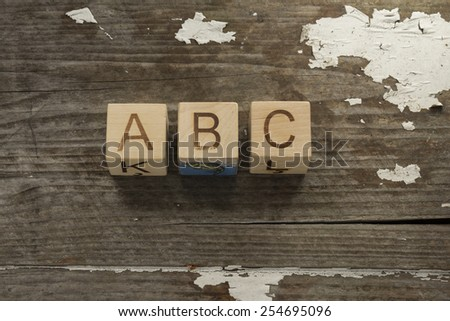 Words. Toy bricks on a wooden background - stock photo