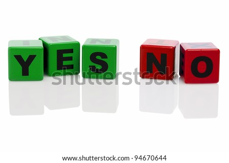 words YES and No spelled with green and red alphabet building blocks