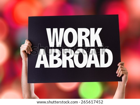 Work Abroad card with bokeh background - stock photo